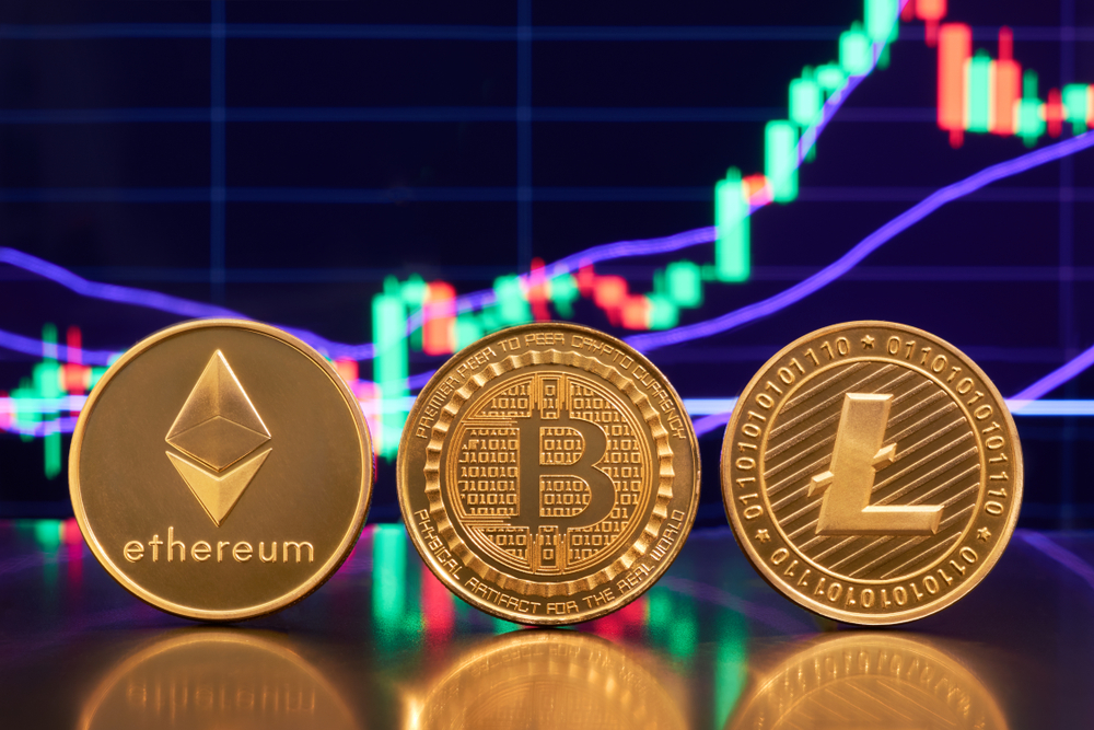 Three gold coins ripple, bitcoin, litecoin against the backdrop of a bright financial business graphics blueprint close-up. Crypto-currency. Anonymous. Virtual currency - Image