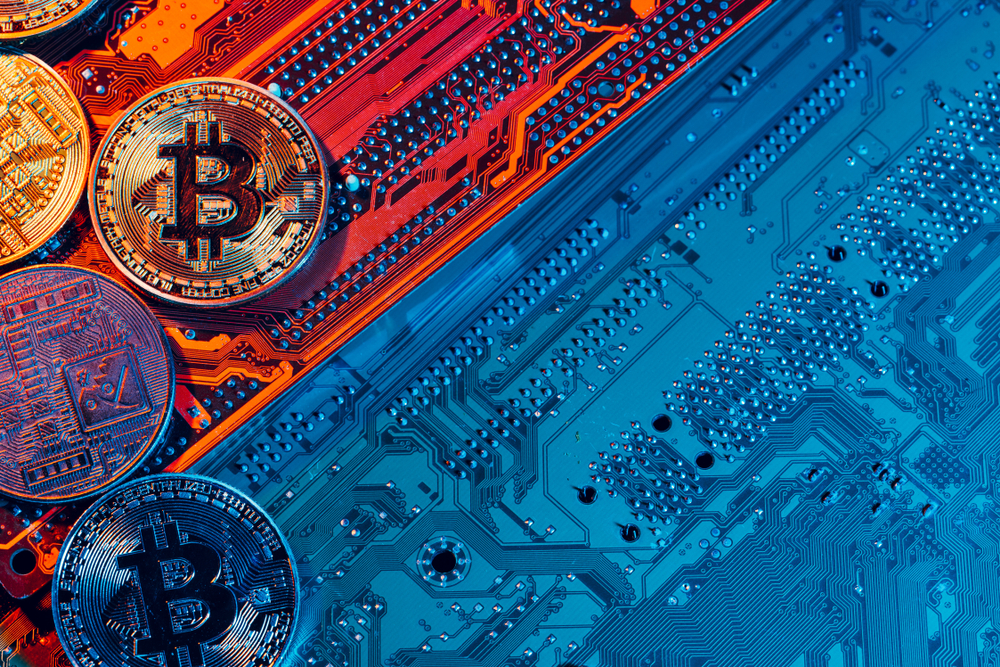 golden bitcoin and computer chip in background - Image